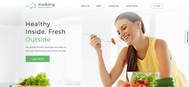 Restaurant website with a photo of a woman smiling and eating a salad.